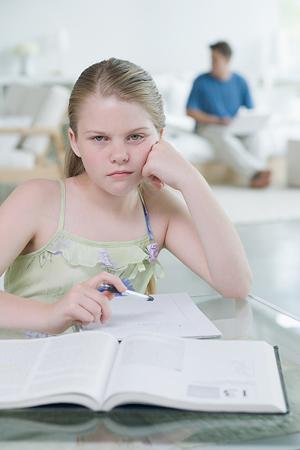 A grumpy looking girl not enjoying her copy writing